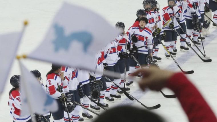 Image: South Koreans wave Korean reunification flags