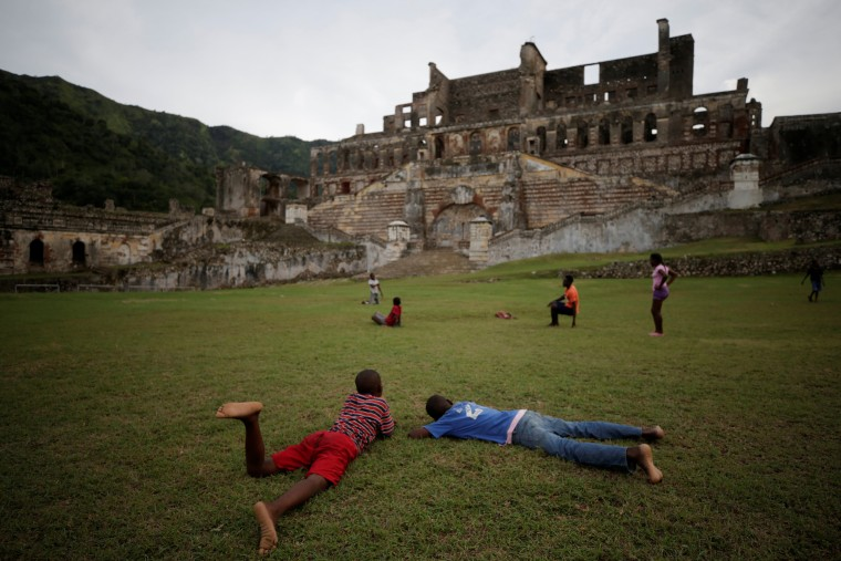 Image: Boys play in the gardens of the remains of Sans-Souci Palace in Milot