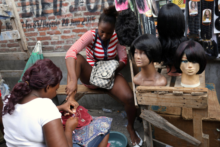 Image: A woman gets a pedicure in Port-au-Prince