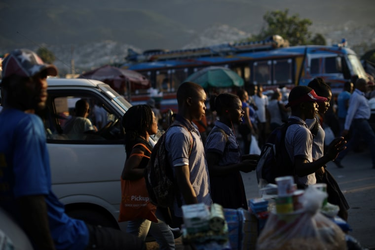 Image: Students walk along a street in Port-au-Prince