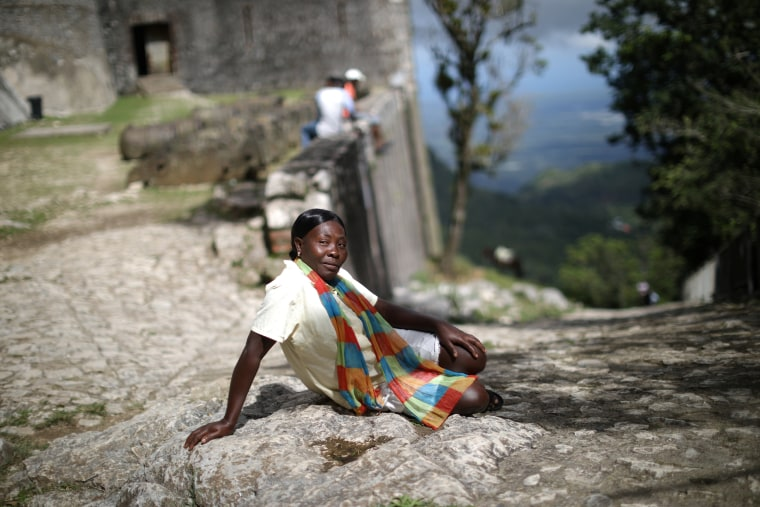 Image: A vendor waits for visitors to arrive to the Citadel Laferriere in Milot
