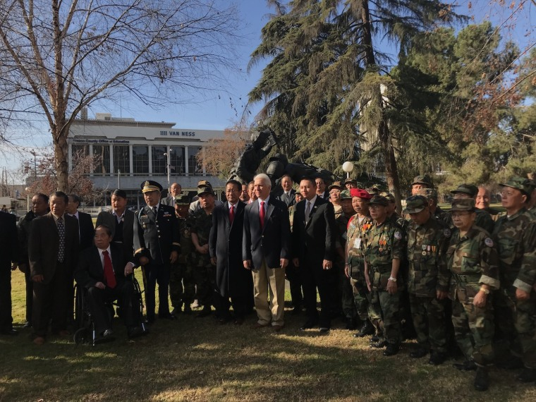Lao- and Hmong-American veterans at a January press conference with Rep. Jim Costa, center, in front of the Lao Hmong American War Memorial in Fresno County, California.
