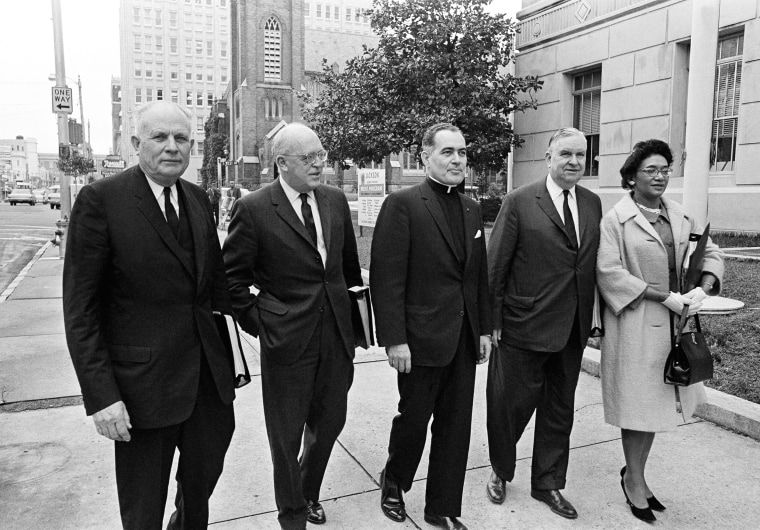 Members of the U.S. Commission on Civil Rights arrive at the Federal building in Jackson, February 10, 1965 to open a hearing concerning denials of voting rights and discrimination of justice. From left are, John A. Hannah, chairman, Robert S. Rankin, Rev. Theodore M. Hesburgh, Erwin N. Griswold and Mrs. Frankie Muse Freeman.