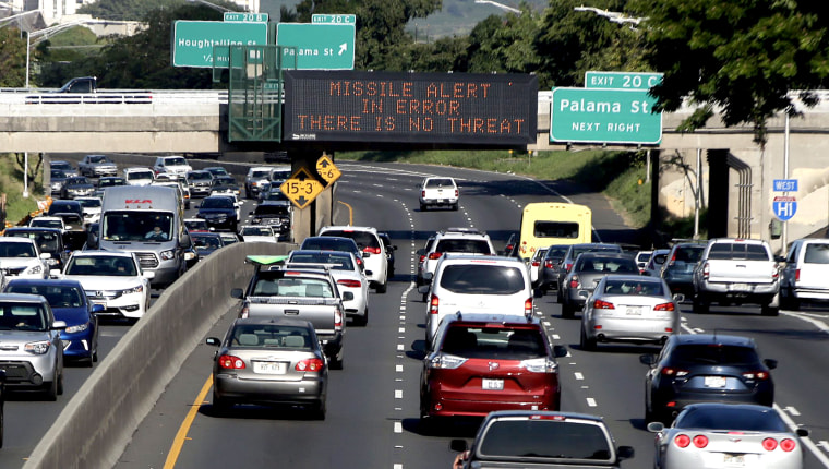 Image: Electronic signs displaying the emergency missile alert being fake in Honolulu on Jan. 13, 2018.