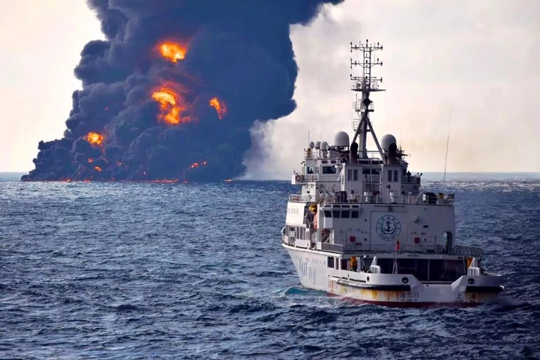 """Image: Smoke and flames rise from the burning Iranian oil tanker """"Sanchi"""" at sea off the coast of eastern China on Jan. 14, 2018."""