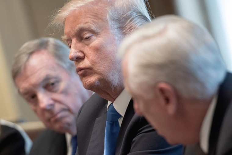 Image: President Donald Trump is flanked by Senator Dick Durbin and Congressman Steny Hoyer during a meeting with bipartisan members of the Senate on immigration at the White House in Washington, DC, on Jan. 9, 2018.