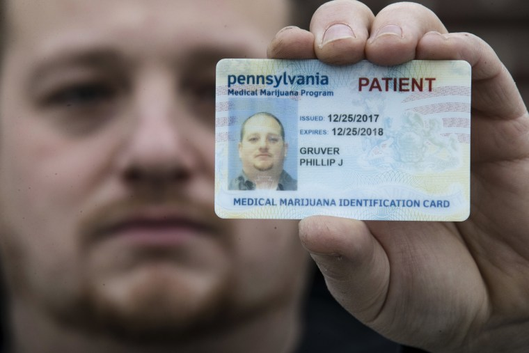 Image: Phil Gruver poses for a photograph in Emmaus, Pennsylvania, as the gun-loving state becomes the latest to operate a medical marijuana program.
