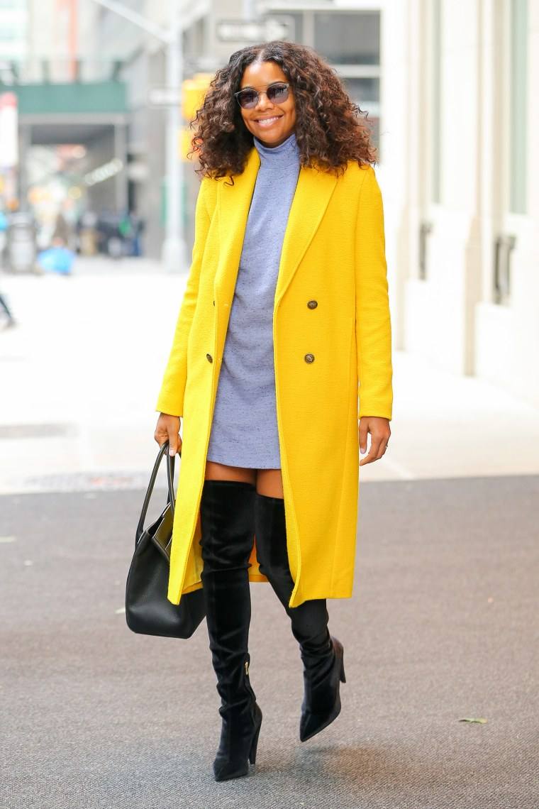 Gabrielle Union is all smiling while steps out wearing 'Forever Or Never' in a bright yellow coat in New York City