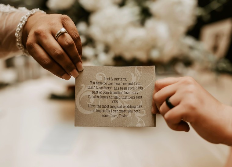 Gonzales and Lewis received Swift's surprise moments before walking down the aisle. They both read the note separately, so as not to ruin the big bridal gown reveal.