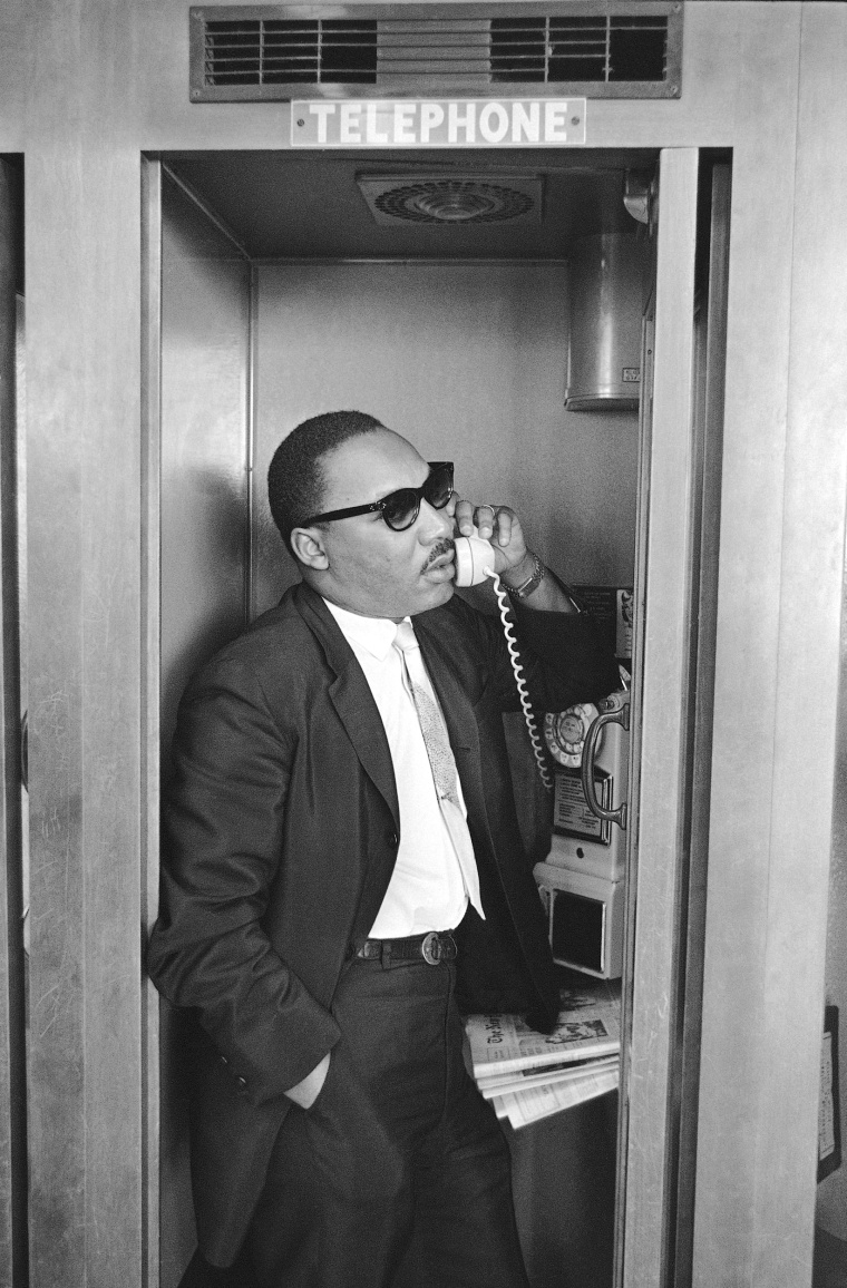 Image: King telephones aides during a stopover in Miami