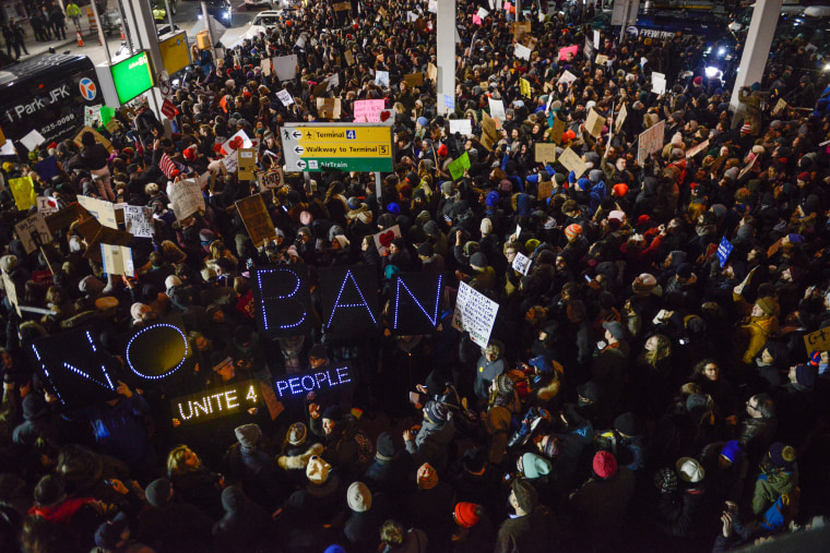 Image: Protesters rally  during a demonstration against the Muslim immigration ban at John F. Kennedy International Airport on Jan. 28, 2017 in New York.
