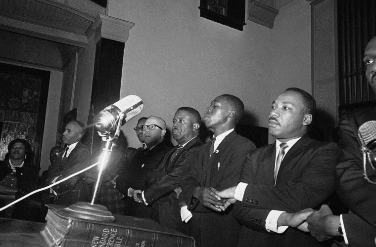 "Image: Martin Luther King, Jr., joins hands with other African American leaders singing ""We Shall Overcome"""