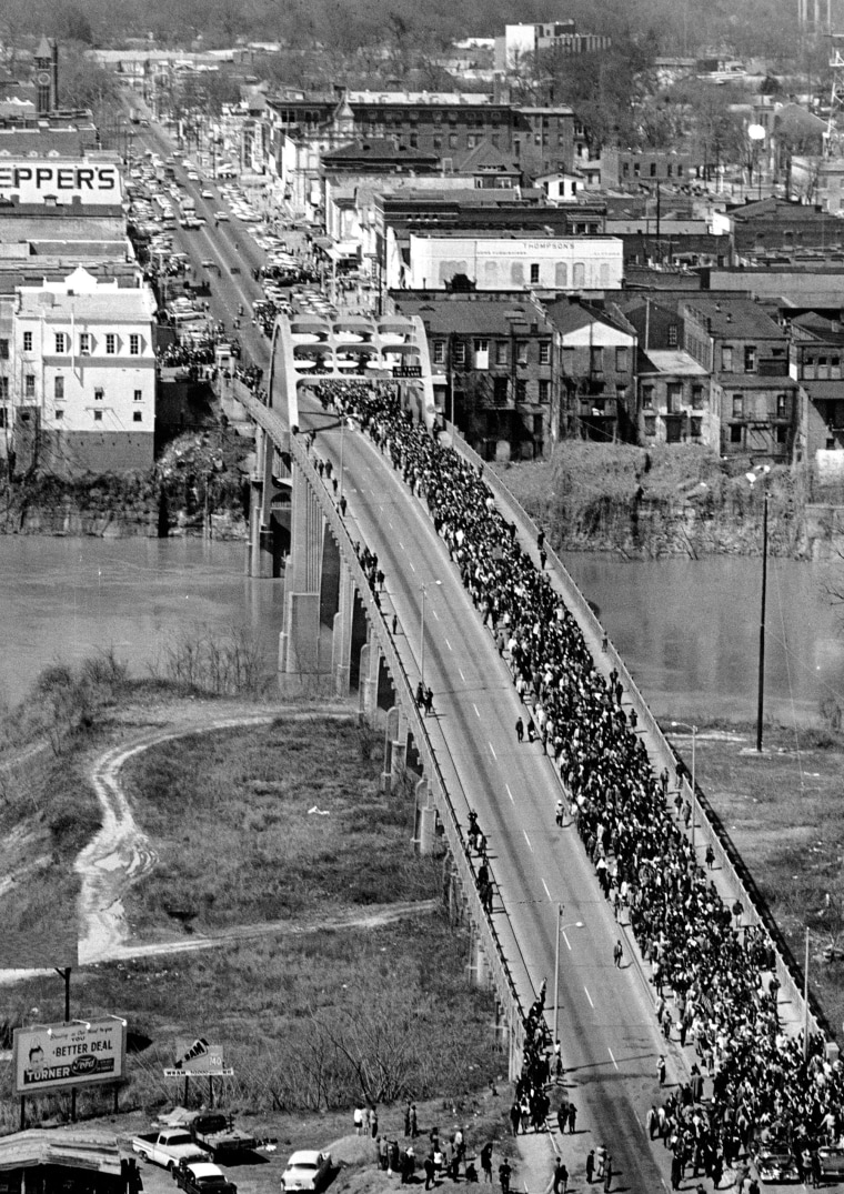 Image: Martin Luther King Jr. leads civil rights demonstrators cross the Alabama River