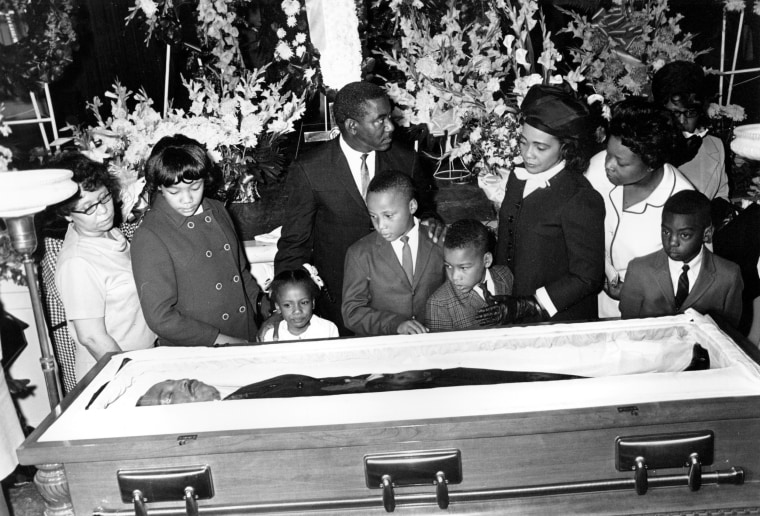 Image: Coretta Scott King, and her four children view the body of her husband