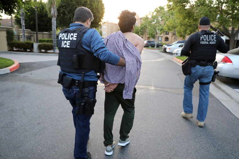 Image: An ICE agent arrests an Iranian immigrant in San Clemente, Calif.