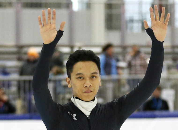 Image: Aaron Tran waves to the crowd following the men's 500-meter