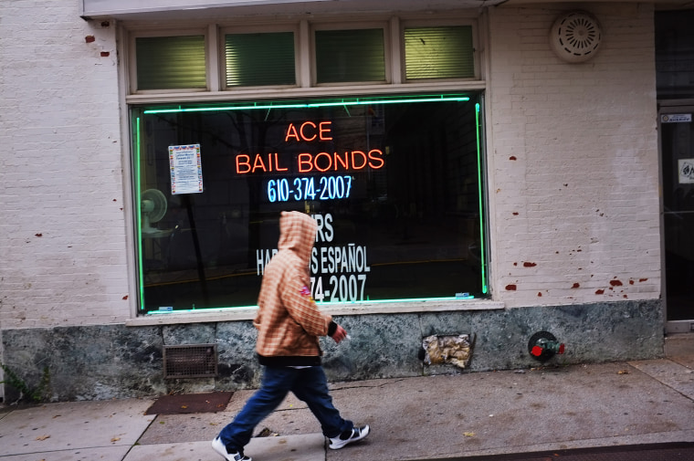 Image: A man walks by a bail bonds store on Oct. 20, 2011 in Reading, Pennsylvania.