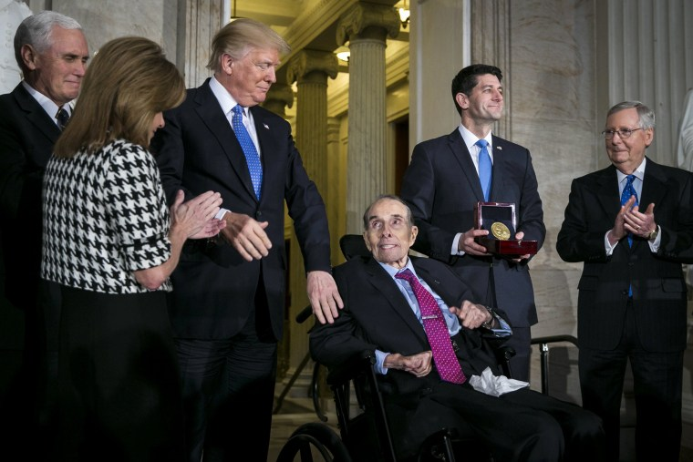 Image: President Donald Trump greets Dole as he is presented with the congressional Gold Medal
