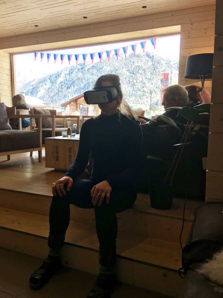 Laurenne Ross uses a VR headset in a hotel lobby in St. Mortiz during the 2016 World Championships, prior to her injury.
