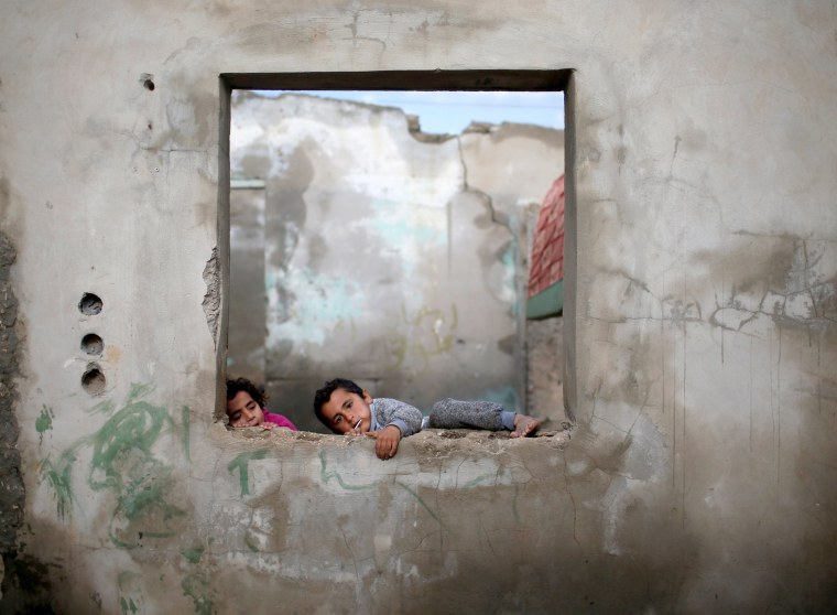 Image: Children play at their family's house in the Al-Shati refugee camp on Jan. 15.