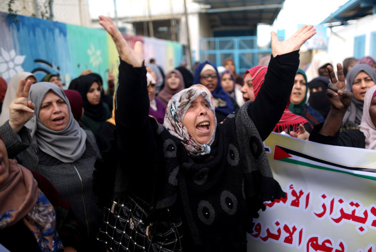 Image: Palestinian women protest outside of the United Nations' offices in the al-Nusirat camp in the Gaza strip on Jan. 17, after the White House froze tens of millions of dollars in contributions.
