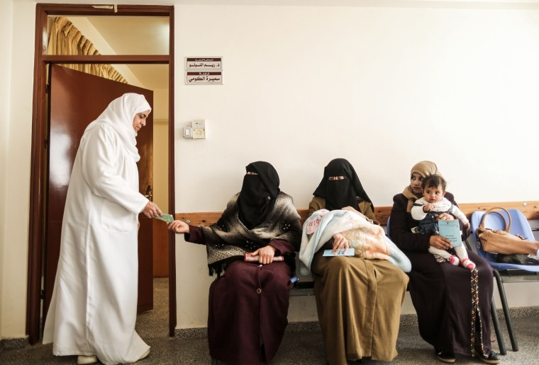 Image: Women sit in a waiting room at an UNRWA-run clinic in the al-Nusirat refugee camp on Jan. 17.