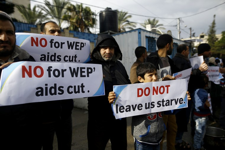 Image: Palestinians take part in a protest against aid cuts outside of United Nations' offices in Gaza City on Jan. 17.