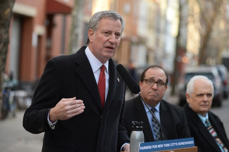 Mayor Bill de Blasio holds a press conference on the streets in the Greenpoint section of Brooklyn to applaud the decision from the New York Court of Appeals to uphold the Water Board's issuance of credits to homeowners on Dec. 20, 2017.