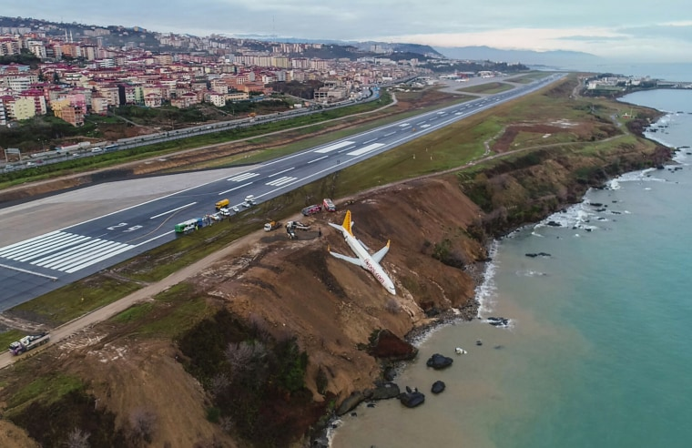 Image: A plane dangles precariously off a muddy cliff in northern Turkey