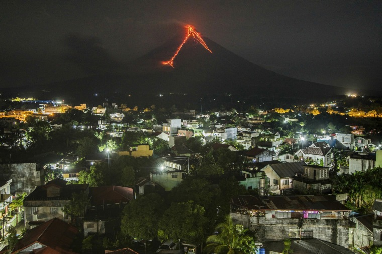Image: Lava cascades down the slopes of the Mayon volcano