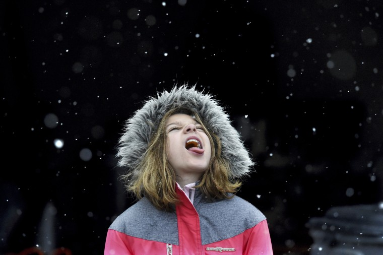 Image: Alison Brown, 9, catches snow flakes on her tongue during a snow storm in Evans, Georgia
