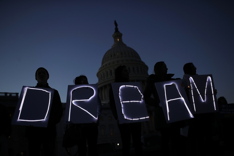 Image: Protesters advocating for the DREAM Act hold a candlelight vigil