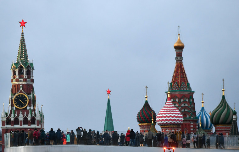 Image: The Spasskaya (Savior) Tower of the Moscow Kremlin and domes of the Intercession of the Most Holy Theotokos on the Moat Cathedral (St. Basil's Cathedral) in Moscow.