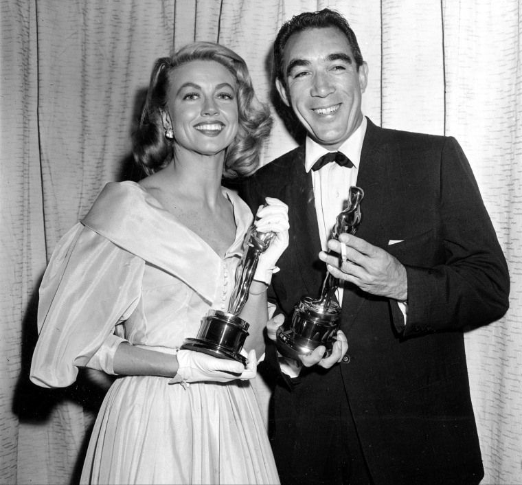 Image: Best supporting Oscar winners Dorothy Malone and Anthony Quinn pose at the Academy Awards in Hollywood, California on March 27, 1957.