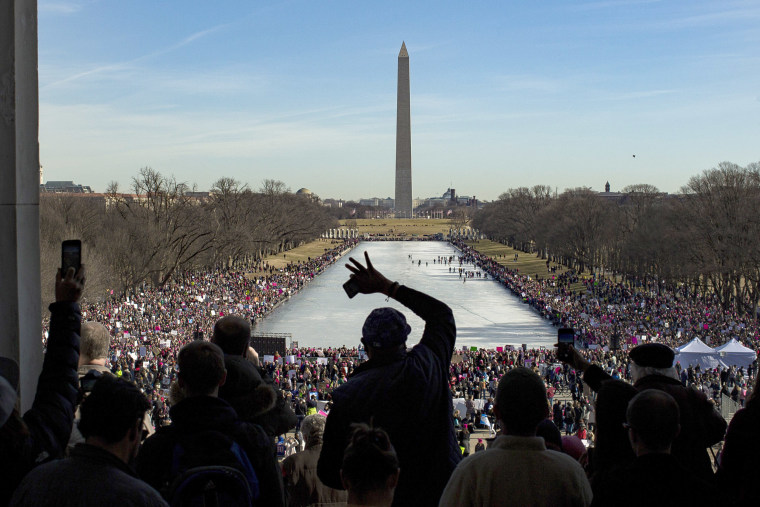 Image: People gather during the Women's March around Lincoln Memorial in Washington, DC, on Jan. 20, 2018 in Washington.