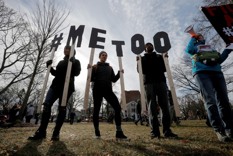 "Image: Demonstrators spell out ""#METOO"" during the local second annual Women's March in Cambridge"