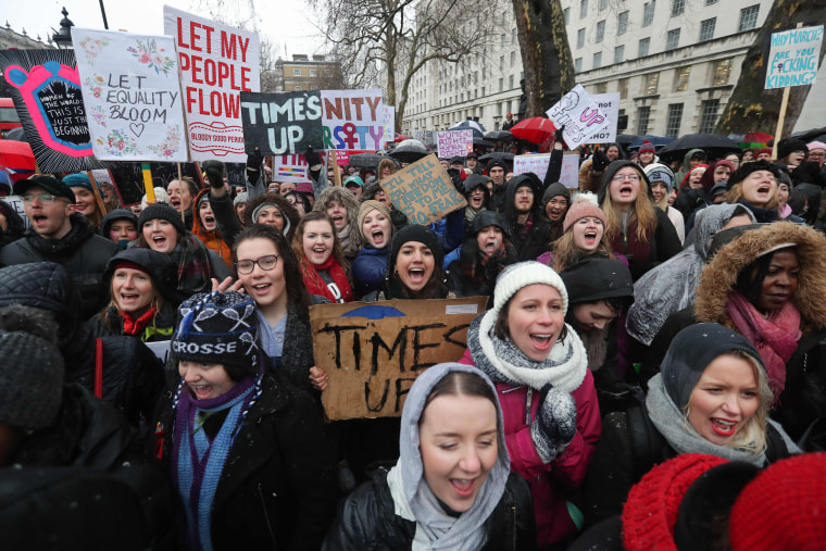 Image: Protesters hold up placards and chant during the Women's March in London on Jan. 21, 2018 as part of a global day of protests, a year to the day since Donald Trump took office as president.