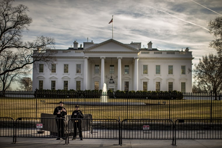 Image: Police stand guard in front of the White House as the second annual Women's March gets underway in Washington, DC, on Jan. 20, 2018.