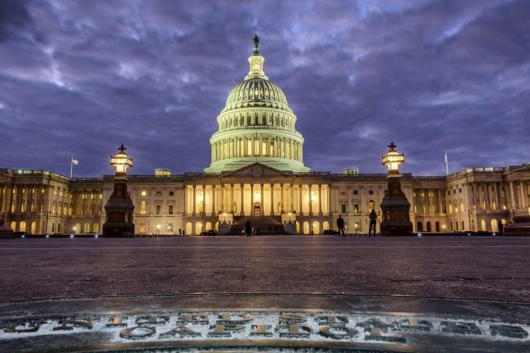 Image: Lights shine inside the U.S. Capitol Building as night falls in Washington