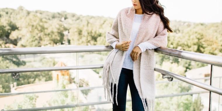 Woman on balcony wearing scarf