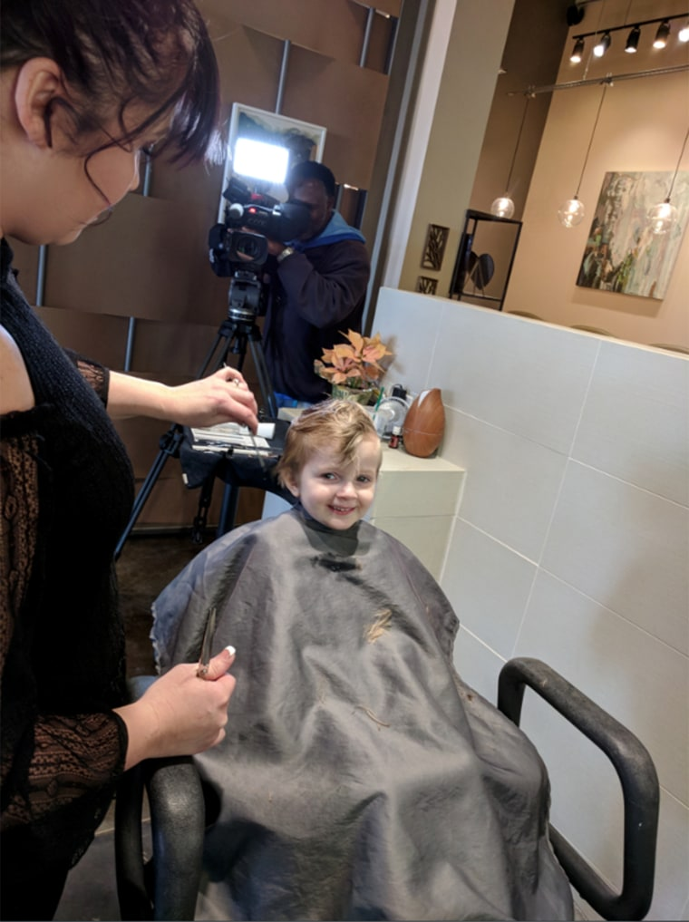 Teig Harris, now cancer free, gets her first haircut at the age of four after years of chemo therapy.