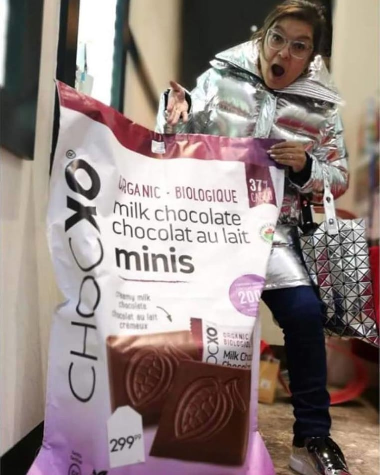 Woman behind a giant bag of ChocXO chocolates