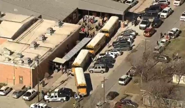 Image: Students are evacuated after a school shooting in Italy, Texas