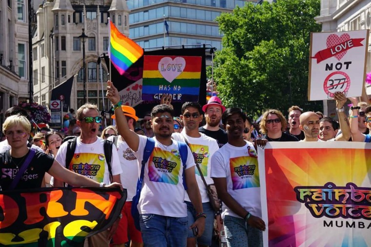 Members of Rainbow Voices Mumbai participating in the London Pride March in July 2017. Choir director David Williamson is second from left, and Ashish Pandya is in the middle holding a rainbow flag.
