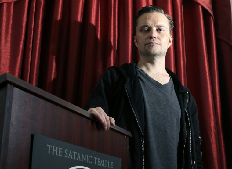 Image: Lucien Greaves stands inside the international headquarters of the Satanic Temple