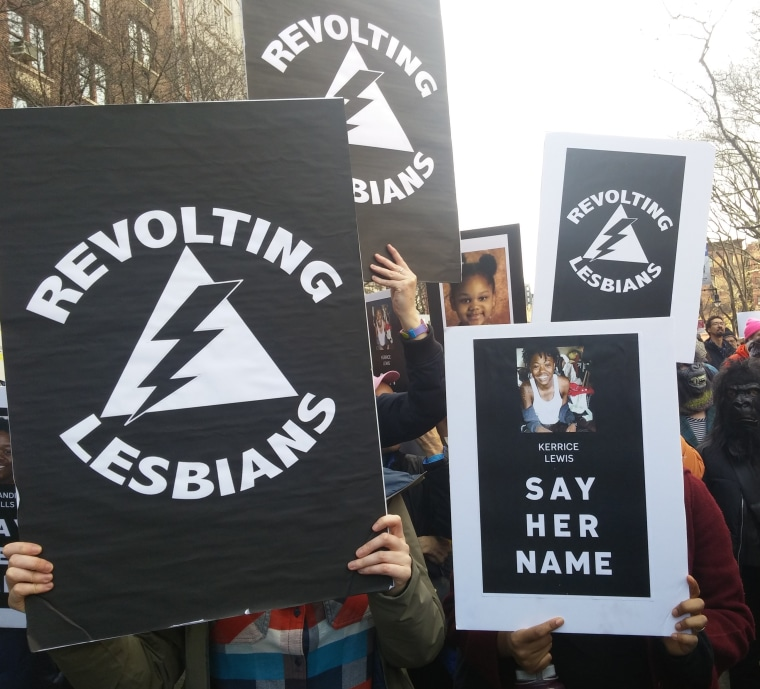 Members of the group Revolting Lesbians hold up signs at the Women's March in New York City on Jan. 20, 2018.