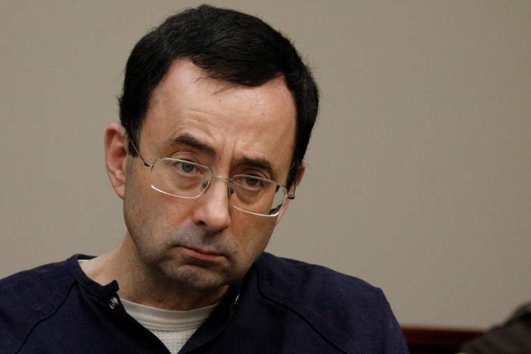 Image: Larry Nassar, a former team USA Gymnastics doctor who pleaded guilty in November 2017 to sexual assault charges, sits in the courtroom during his sentencing hearing in Lansing, Michigan