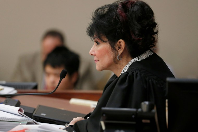 Image: Judge Rosemarie Aquilina watches victims as Larry Nassar listens to impact statement