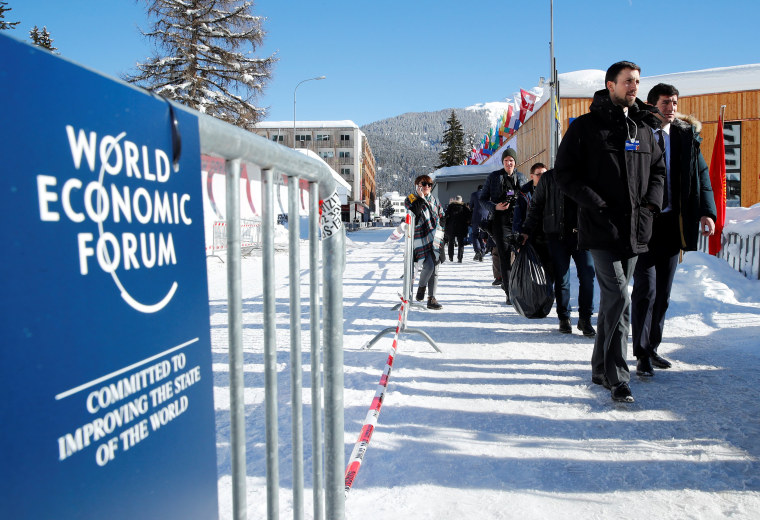 Image: Attendees arrive for the World Economic Forum (WEF) annual meeting in Davos