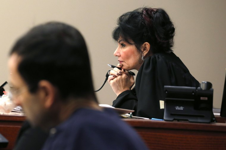 Image: Judge Rosemarie Aquilina watches as Larry Nassar listens to impact statements